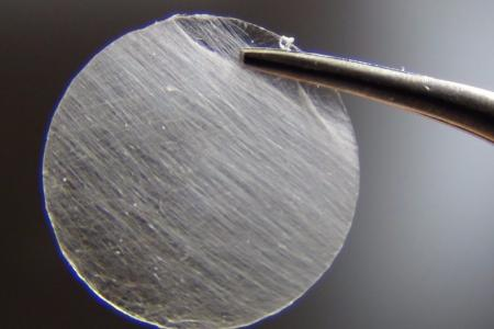 Detail of a nanofiber spool produced by an ultra-fast, touch-spinning technology which can produce thousands of yards of nanofibers in a matter of minutes.